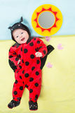 Pretty child girl, dressed in ladybug costume Royalty Free Stock Image