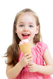 Pretty child girl eating ice cream Stock Images