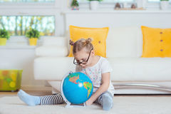 Pretty child girl at home dreaming of travel and tourism, explor Stock Images