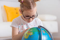 Pretty child girl at home dreaming of travel and tourism, explor Stock Photography