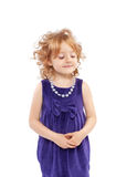 Pretty child with gold hair confused smile Royalty Free Stock Image