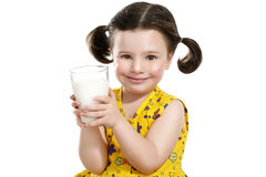 Pretty child holding a big glass of milk Royalty Free Stock Images