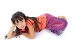 Pretty child lying on floor Royalty Free Stock Photo