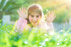 Pretty child playing outdoors Royalty Free Stock Images