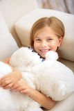 Pretty child playing with teddy bear royalty free stock images