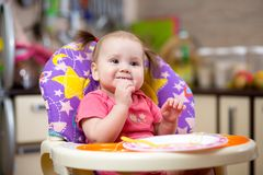 Pretty child toddler eating spaghetti Royalty Free Stock Image