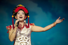 Pretty chinese ethnic singer. CHENGDU - SEP 26: chinese Yi ethnic folk song performed by song and dance troupe of Liangshan Yi autonomous prefecture at JIAOZI Royalty Free Stock Photo