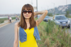 Pretty Chinese girl. With sun glass Stock Image