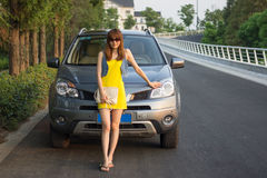 Pretty Chinese girl. With Luxury SUV Stock Photos