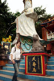 Pretty chinese girl. Taken in Hongkong at the beach. On the picture is also the buddha in front of a temple Stock Photos
