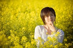 Pretty chinese girl. A girl in casual dress. taken in a field of rape Stock Image
