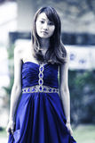 Pretty Chinese girl with blue full dress. In dock Royalty Free Stock Photography