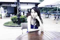 Pretty Chinese girl with blue full dress Stock Image