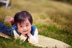 Pretty Chinese girl on grassland