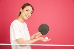 Pretty chinese girl playing ping pong Royalty Free Stock Photos