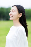 Pretty chinese girl smile in the park Stock Images