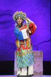 Pretty chinese traditional opera actress with theatrical costume. CHENGDU - JUN 8: Chinese Chu opera performer make a show on stage to compete for awards in 25th Royalty Free Stock Images