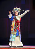 Pretty chinese traditional opera actress with theatrical costume. CHENGDU - JUN 8: Chinese Chu opera performer make a show on stage to compete for awards in 25th Stock Image