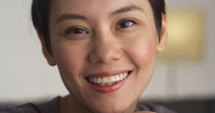 Pretty Chinese woman smiling at camera Royalty Free Stock Photography
