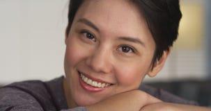 Pretty Chinese woman smiling at camera Stock Photos