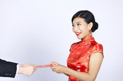 Pretty chinese young woman receiving red pocket for happy chinese new year.  Royalty Free Stock Photos