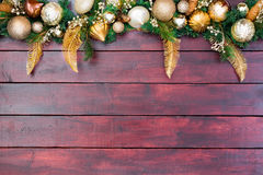 Pretty Christmas border wreath atop wood Royalty Free Stock Images