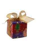 Pretty Christmas Gift. Beautifully wrapped Christmas gift with metallic gold ribbon Stock Images
