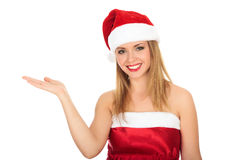 Pretty Christmas girl holding a hand palm up Royalty Free Stock Photography
