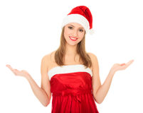 Pretty Christmas girl holding her hands palm up. Royalty Free Stock Photos