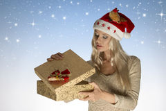 Pretty christmas girl opening gift box Stock Photos