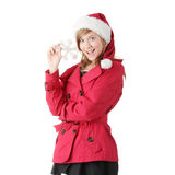 Pretty christmas teen girl in santa hat Stock Photos