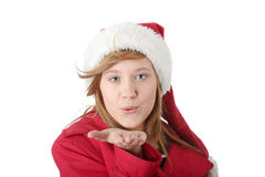 Pretty christmas teen girl in santa hat Stock Image