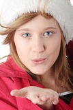 Pretty christmas teen girl in santa hat Royalty Free Stock Images