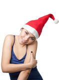 Pretty Christmas woman hugging herself Stock Images