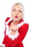 Pretty christmas woman kisses Royalty Free Stock Images