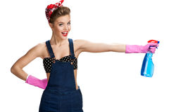 Pretty cleaning lady wearing pink rubber protective gloves holding spray Stock Image