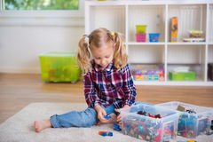 Pretty clever girl play with toy blocks Stock Photography