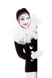Pretty clown looks around the corner Stock Photography