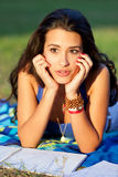 Pretty college girl. Studying outdoors on a campus field Royalty Free Stock Image