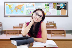 Pretty college student with books in the class Stock Photo