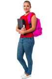 Pretty college student carrying pink backpack Stock Photography