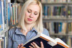 Pretty College Student in a Library royalty free stock images