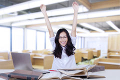 Pretty college student raise hands in class Royalty Free Stock Image