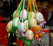 Pretty Colored Easter Eggs hanging on Ribbons Stock Photos