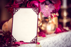 Pretty colored table with invitation note on it Royalty Free Stock Image