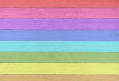 Pretty and Colorful Faux Painted Rustic Wood Boards in Rainbow Color Spectrum for Fun and Cheerful Background template Royalty Free Stock Photography