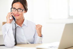 Pretty company secretary conversing on the phone Stock Image
