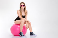 Pretty concentraited young female waiting for a training Royalty Free Stock Image