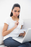 Pretty concentrated woman working with her laptop Royalty Free Stock Image