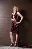 Pretty confident blonde girl in evening dress. Royalty Free Stock Photography
